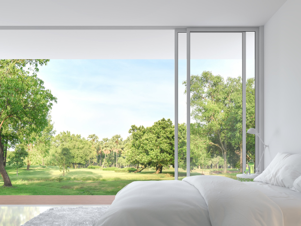 Minimal style bedroom with big windows for natural light