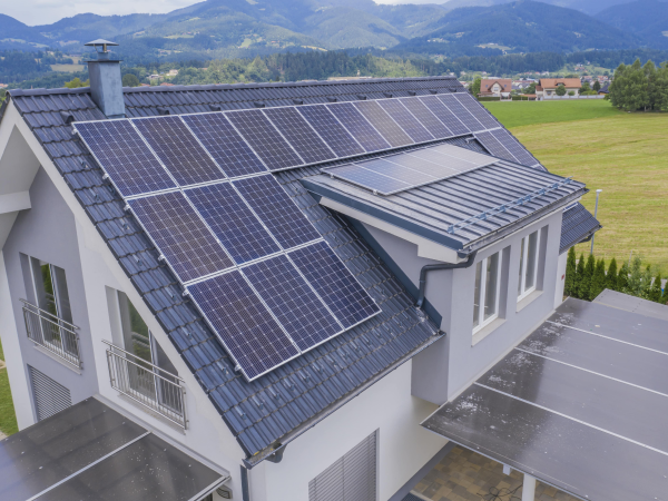 Aerial view of a private house with solar panels on the roof